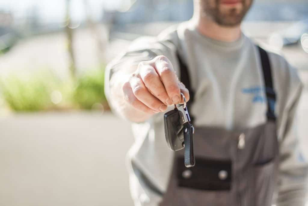 Photo of a man with car keys