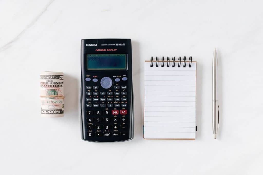 Photo of Calculator, a jotter and a Pen