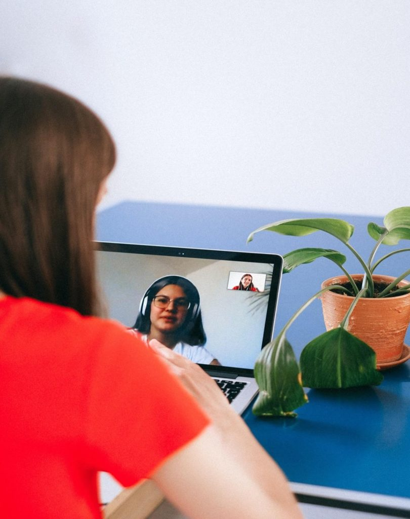 Photo of a woman on a laptop; you can get paid to be a virtual friend