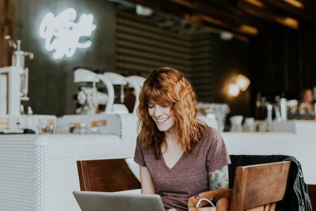 Photo of a woman talking with someone on a laptop