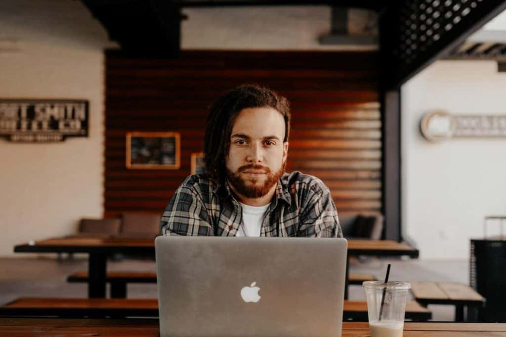 Photo of a man with a laptop