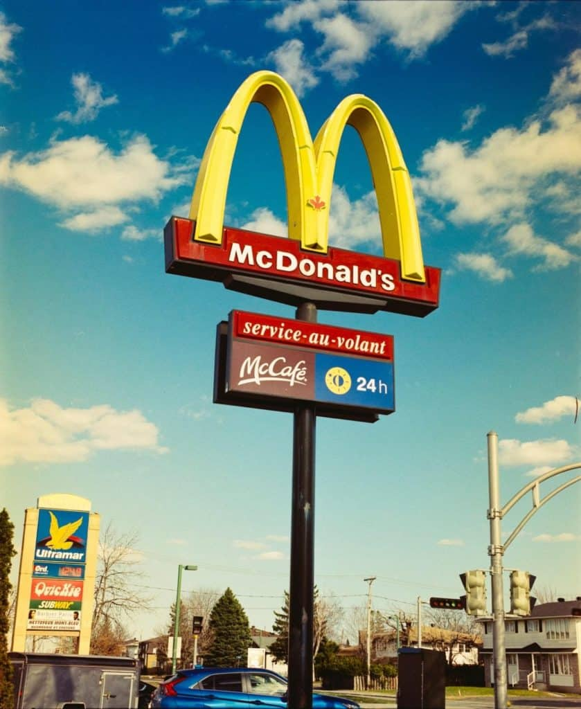 Photo of MC Donalds sign post; get paid to advertise big companies