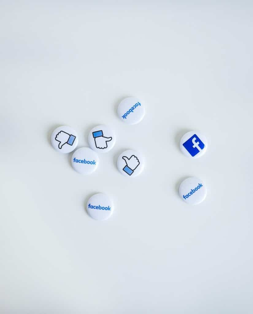 Photo of Facebook logo and signs; social media marketing is a great way to get paid to advertise