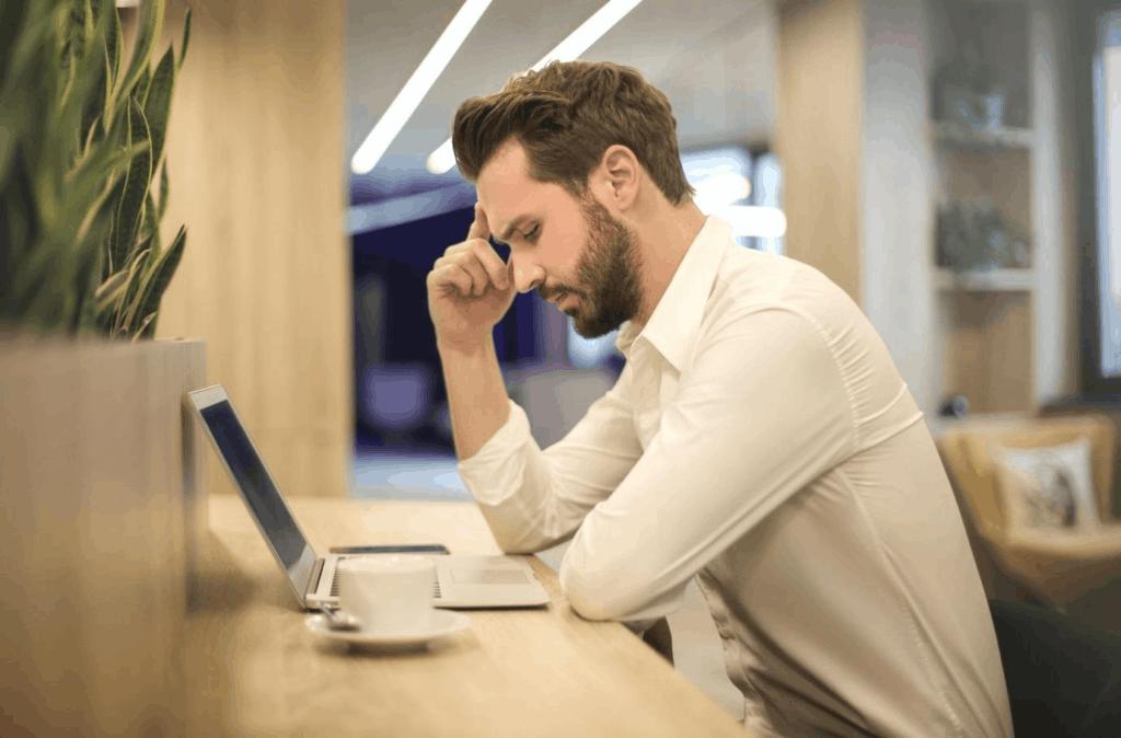 Photo ofa man on a laptop