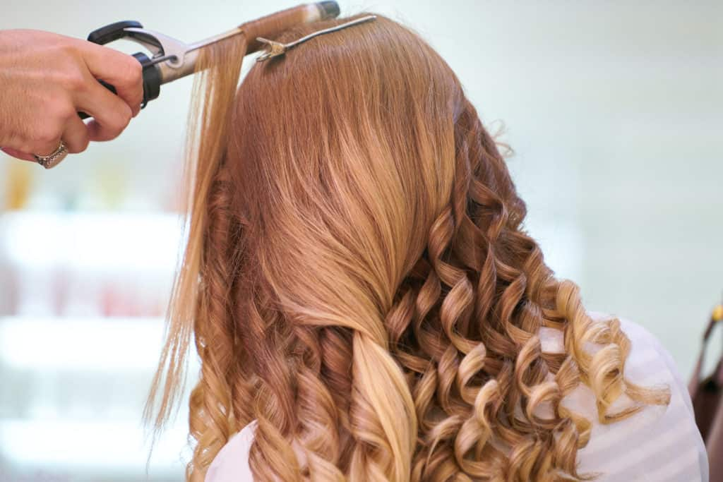 Photo of a hairstylist; part of good Under The Table Jobs