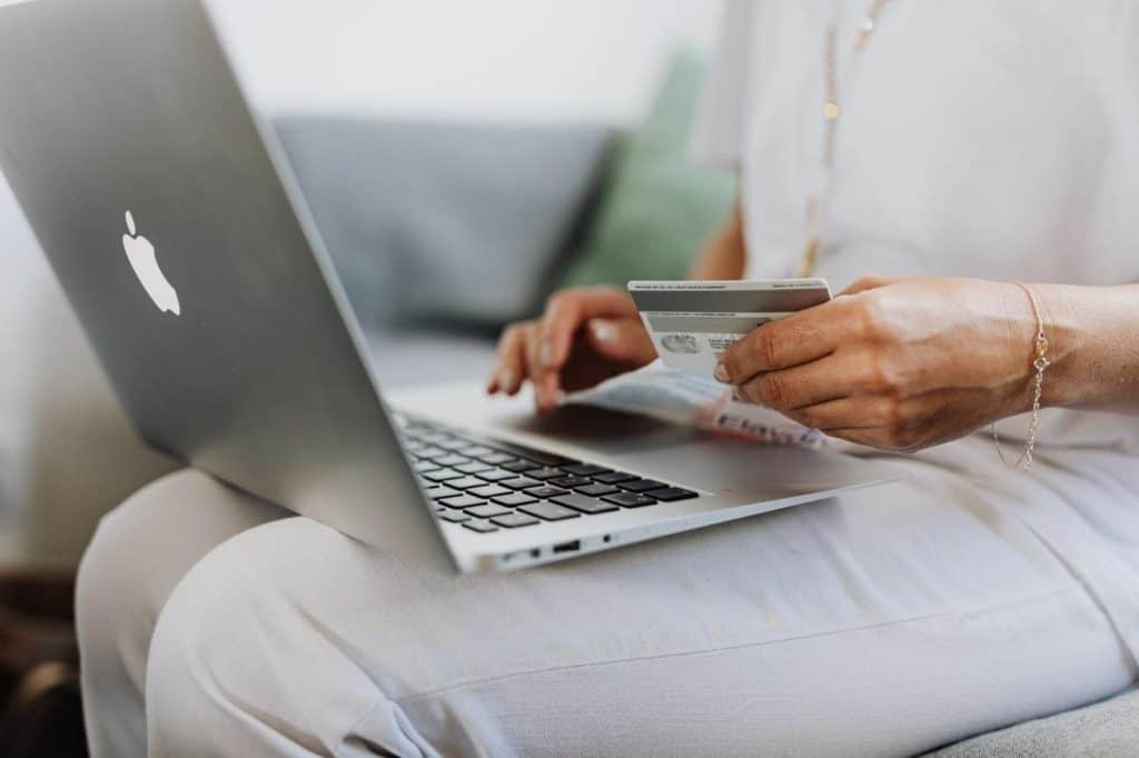 Photo of a woman shopping online with her card