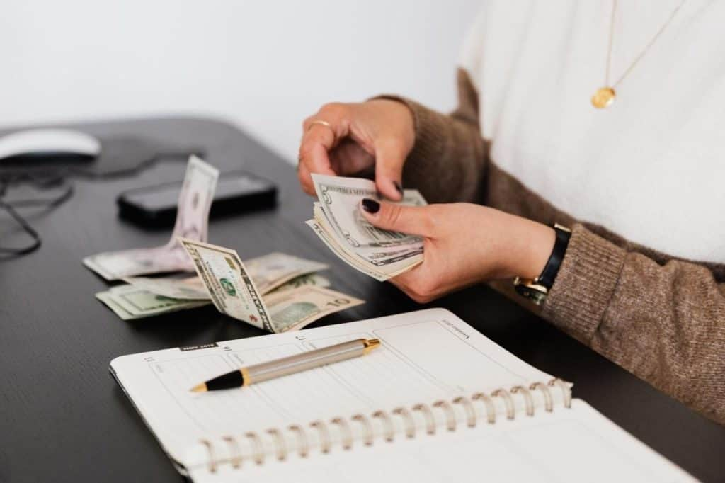 Photo of a woman counting cash