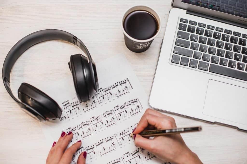 Photo of someone transcribing songs; get paid to type lyrics