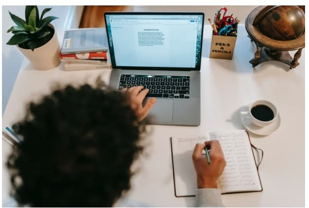 Photo of a writer, you can get paid to write on some sites