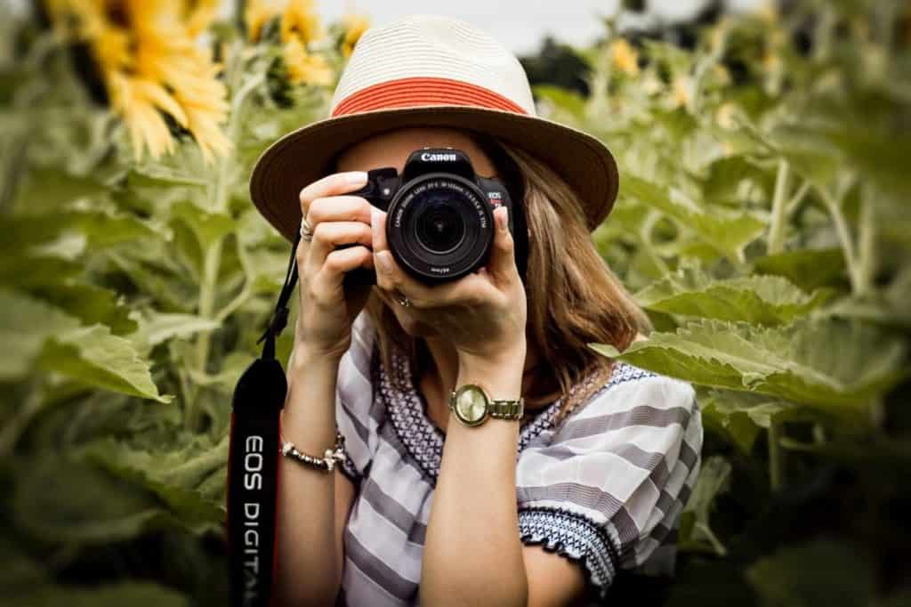 Photo of a photographer; photography is an avenue if you are looking for how to make money as a teenager