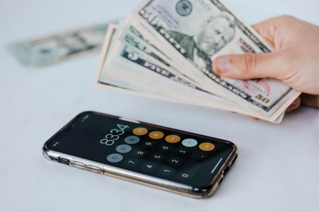 Photo of cash and a calculator;  getting free money on cash app is free and easy