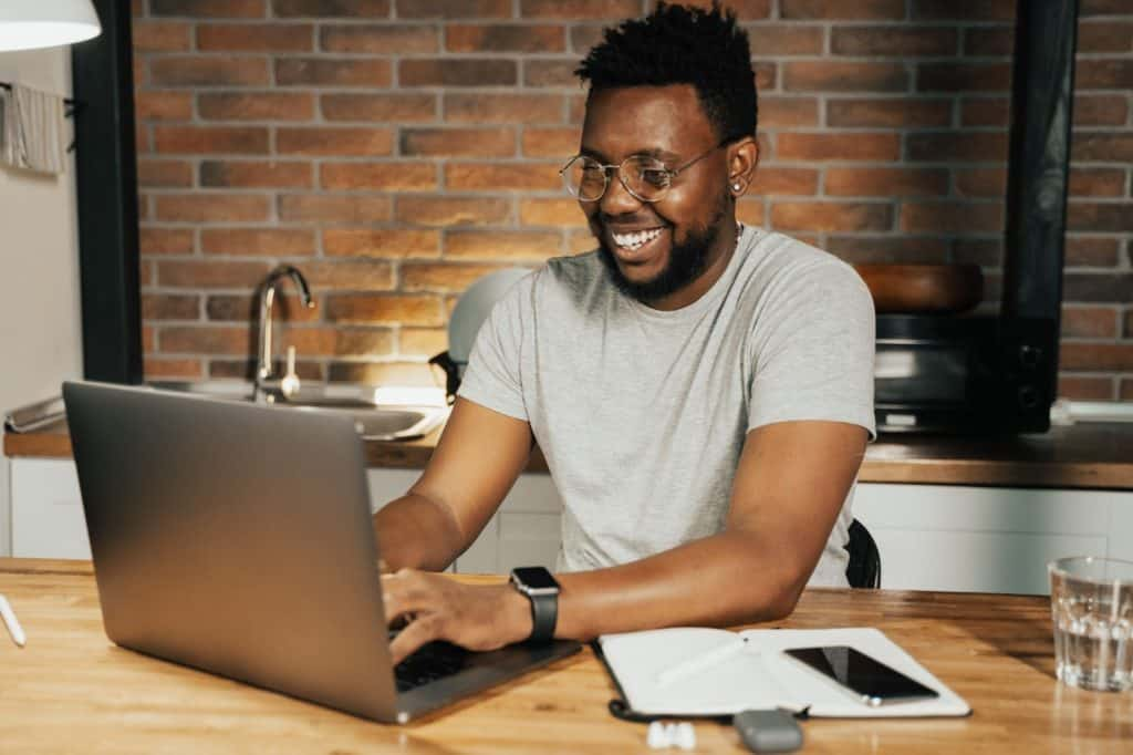Photo of a man working on a laptop; there are various online typing jobs you can do from home