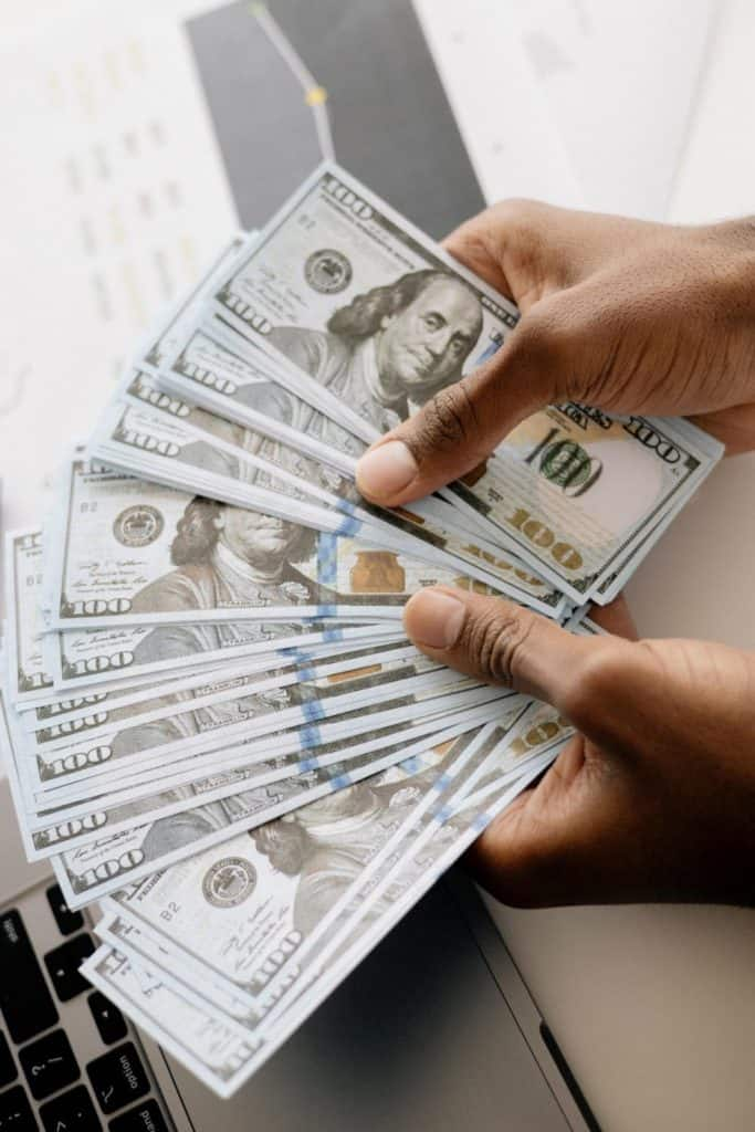 Photo of money that is up to 6 figures