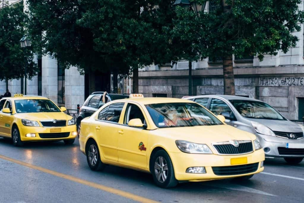 Photo of a taxi, you can use your car for Uber or Lyft when you need money now